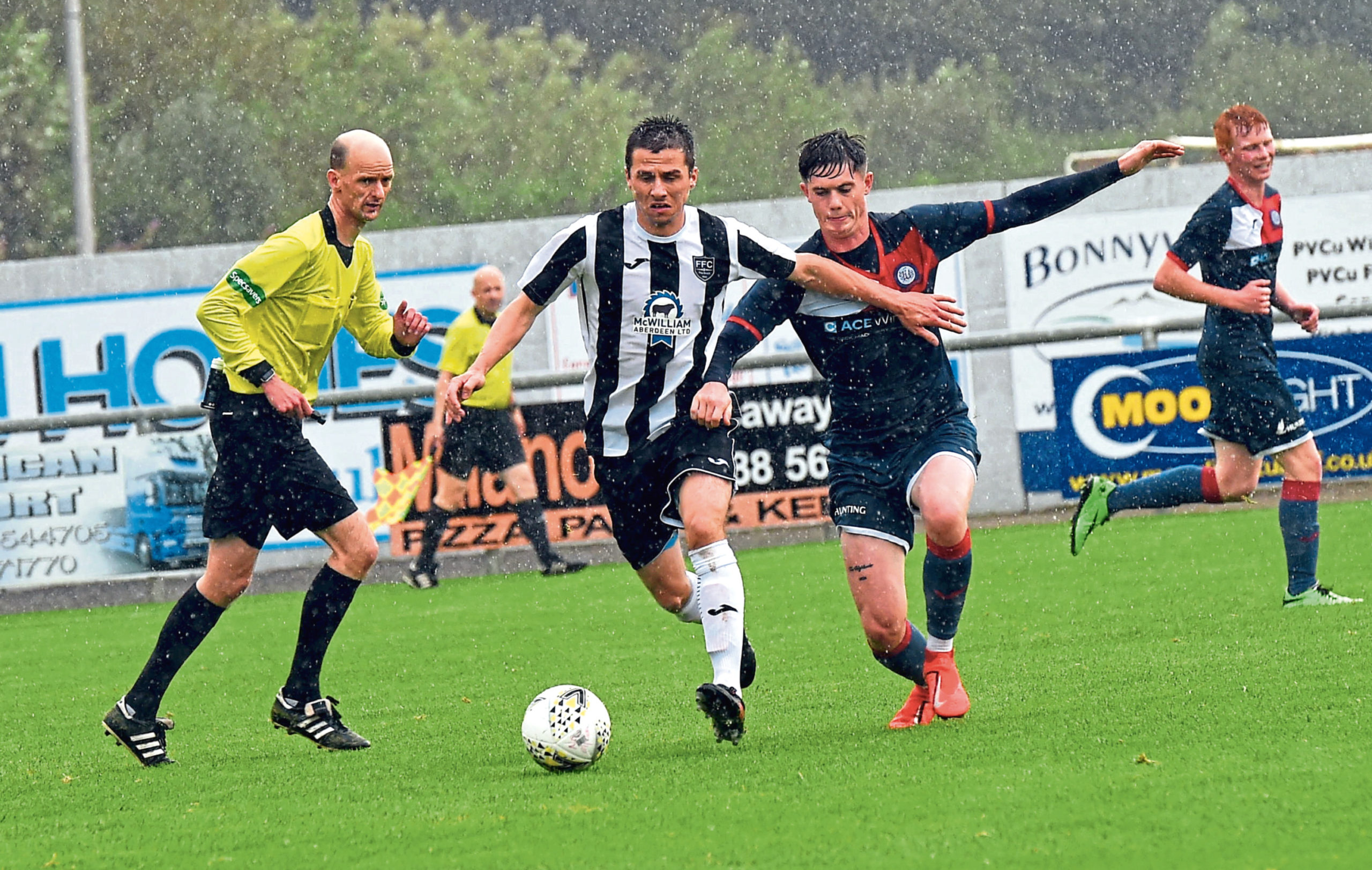 Paul Young drives forward with the ball for the Broch.