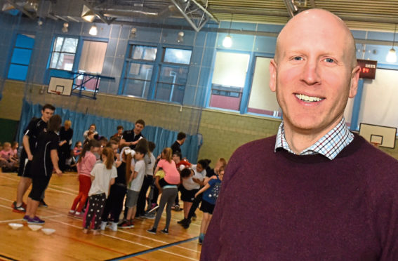The youngsters of Kaimhill Primary school at the Aberdeen Youth games launch at RGU Sport hall, Garthdee, Aberdeen. In the picture is Graeme Dale, senior development manager (Young People) for Sport Aberdeen.