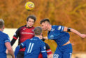 Luc Bollan, right, in action for Peterhead.