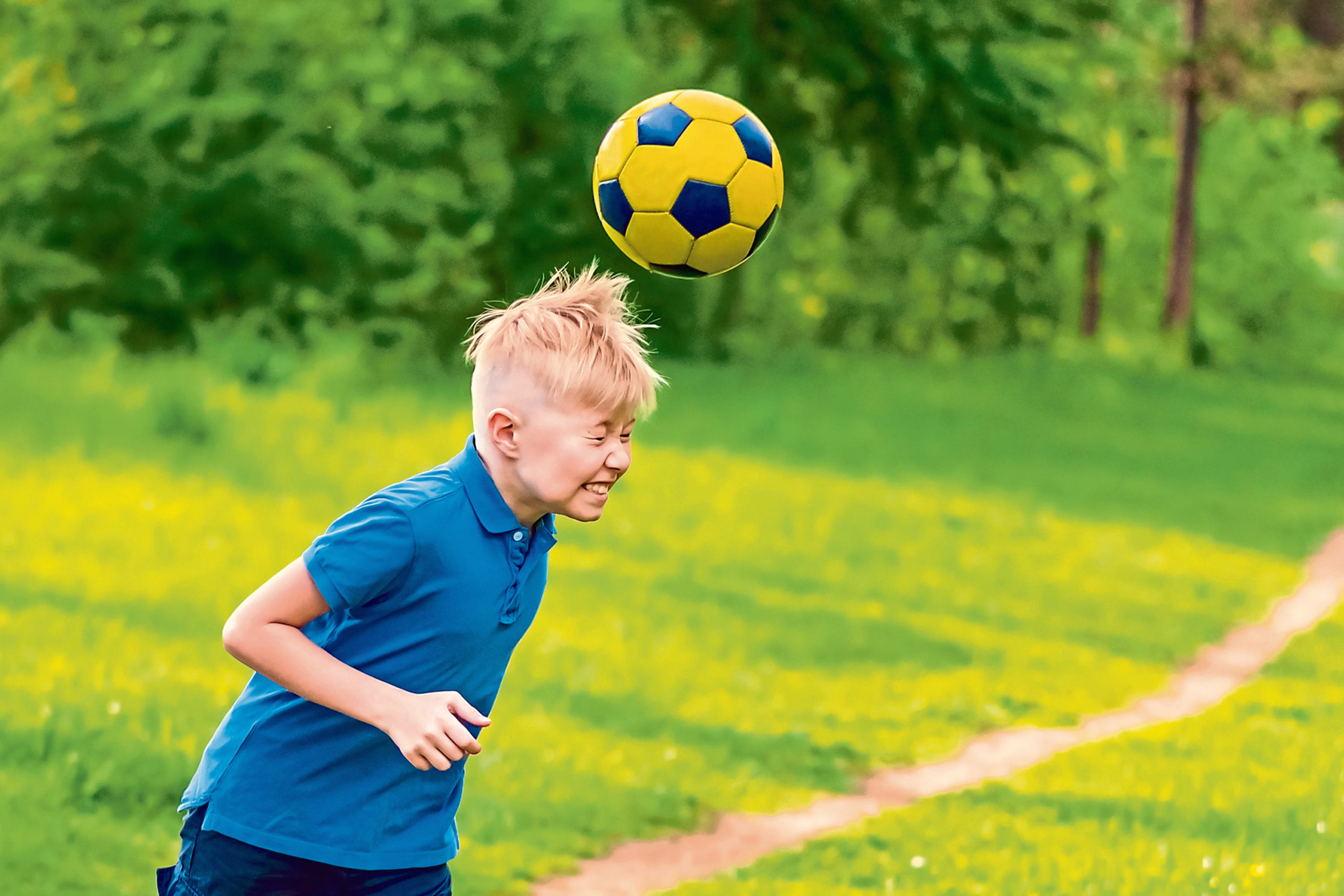 "A ban on heading the football has been hailed as a ""positive step"""