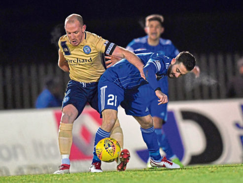 Steven Boyd clashes with Gary Irvine.