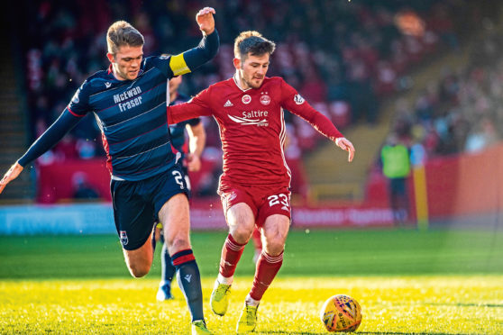Matty Kennedy, right, in action against Ross County.