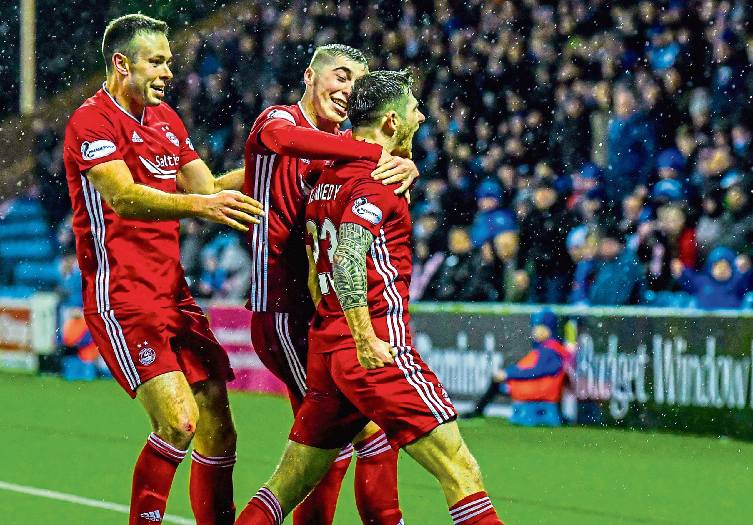Matty Kennedy is congratulated after scoring for Aberdeen.