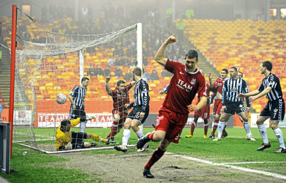 Aberdeen celebrate Chris Maguire's goal.