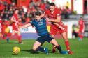 Andy Considine, right, in action during the Ladbrokes Premiership match between Aberdeen and Ross County at Pittodrie.