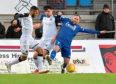Jamie Stevenson, right, in action for Peterhead.