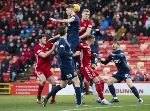 ABERDEEN, SCOTLAND - FEBRUARY 08: Kilmarnock's Connor Johnson and Aberdeen's Sam Cosgrove rise for the ball during the Scottish Cup 5th round tie between Aberdeen and Kilmarnock at Pittodrie Stadium on February 08, 2020, in Aberdeen, Scotland. (Photo by Alan Harvey / SNS Group)