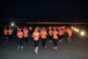 Participants run two lengths of the 3.5km-long runway
