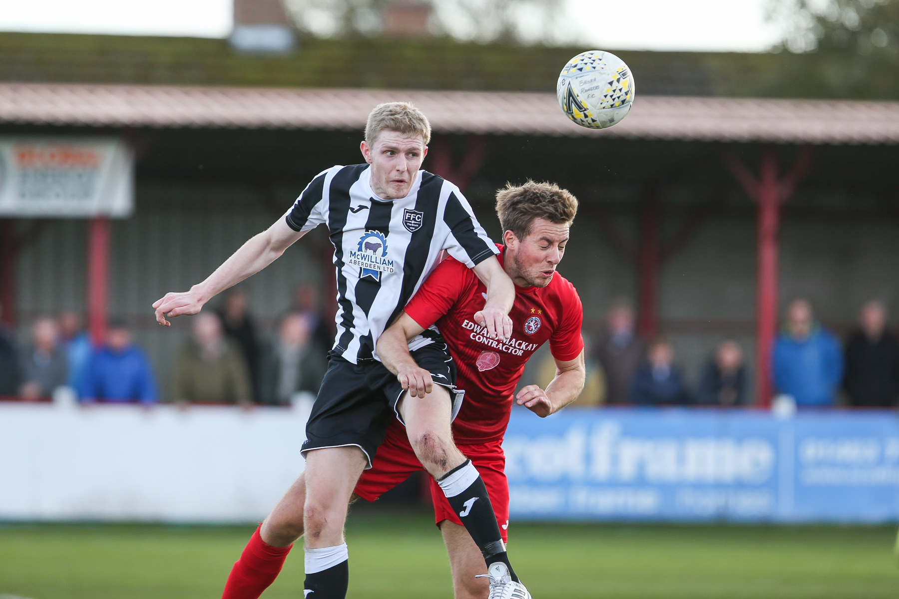 Fraserburgh's Ross Willox out jumps Brora's Martin MacLean earlier in the season.