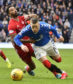 GLASGOW, SCOTLAND - FEBRUARY 1: Aberdeen's Shay Logan (left) pulls back Rangers' Ryan Kent during a Ladbrokes Premiership match between Rangers and Aberdeen at Ibrox Park, on February 1, 2020, in Glasgow, Scotland.