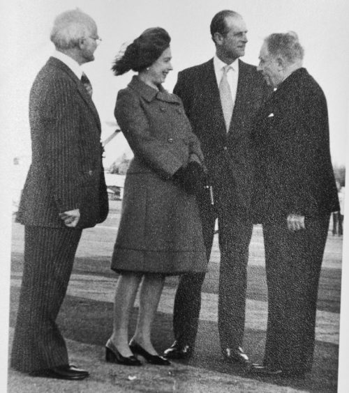 Eric Gander Dower, right with the Queen and Prince Philip
