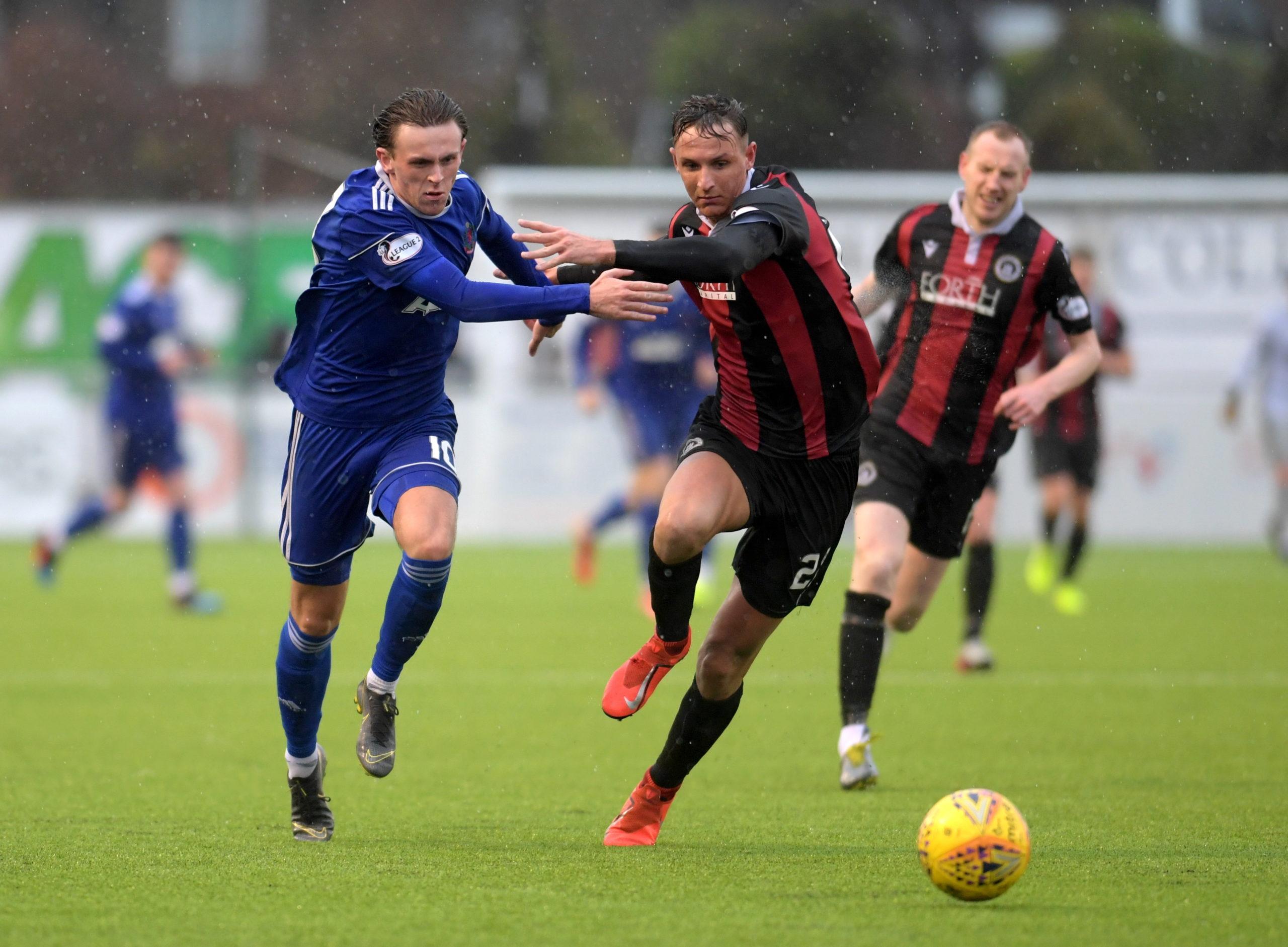 Broque Watson (left) in action against Edinburgh City.