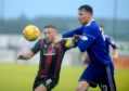 Edinburgh's Craig Thompson and Cove's Rory McAllister. Picture by Kath Flannery