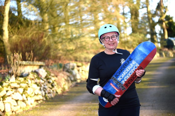 """Elaine Shallcross, 68, has breast cancer, and having never  skateboarded before, is preparing to perform a """"shove-it"""" skateboard trick for her 69th birthday in July"""