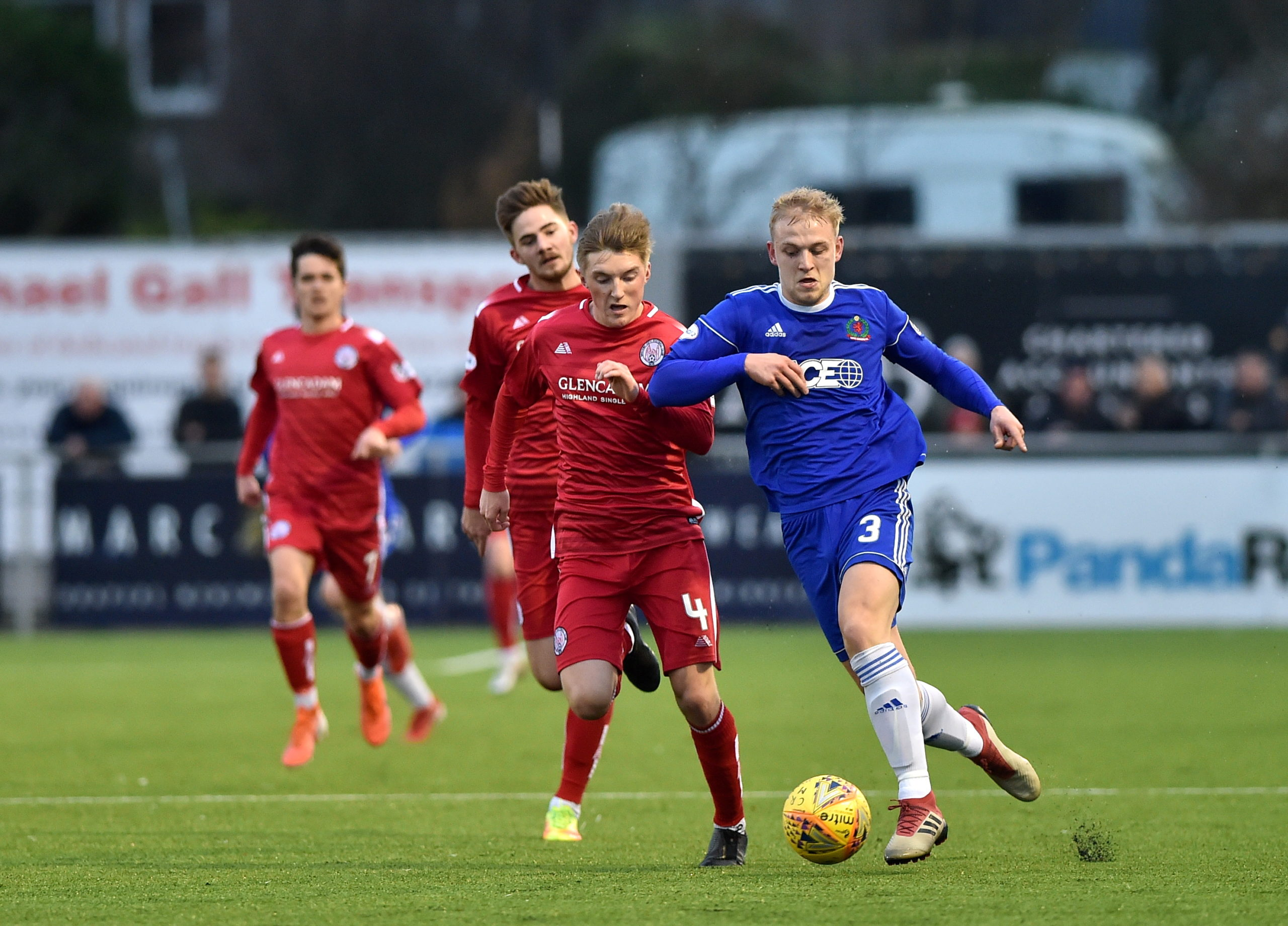 Harry Milne drives forward for Cove.