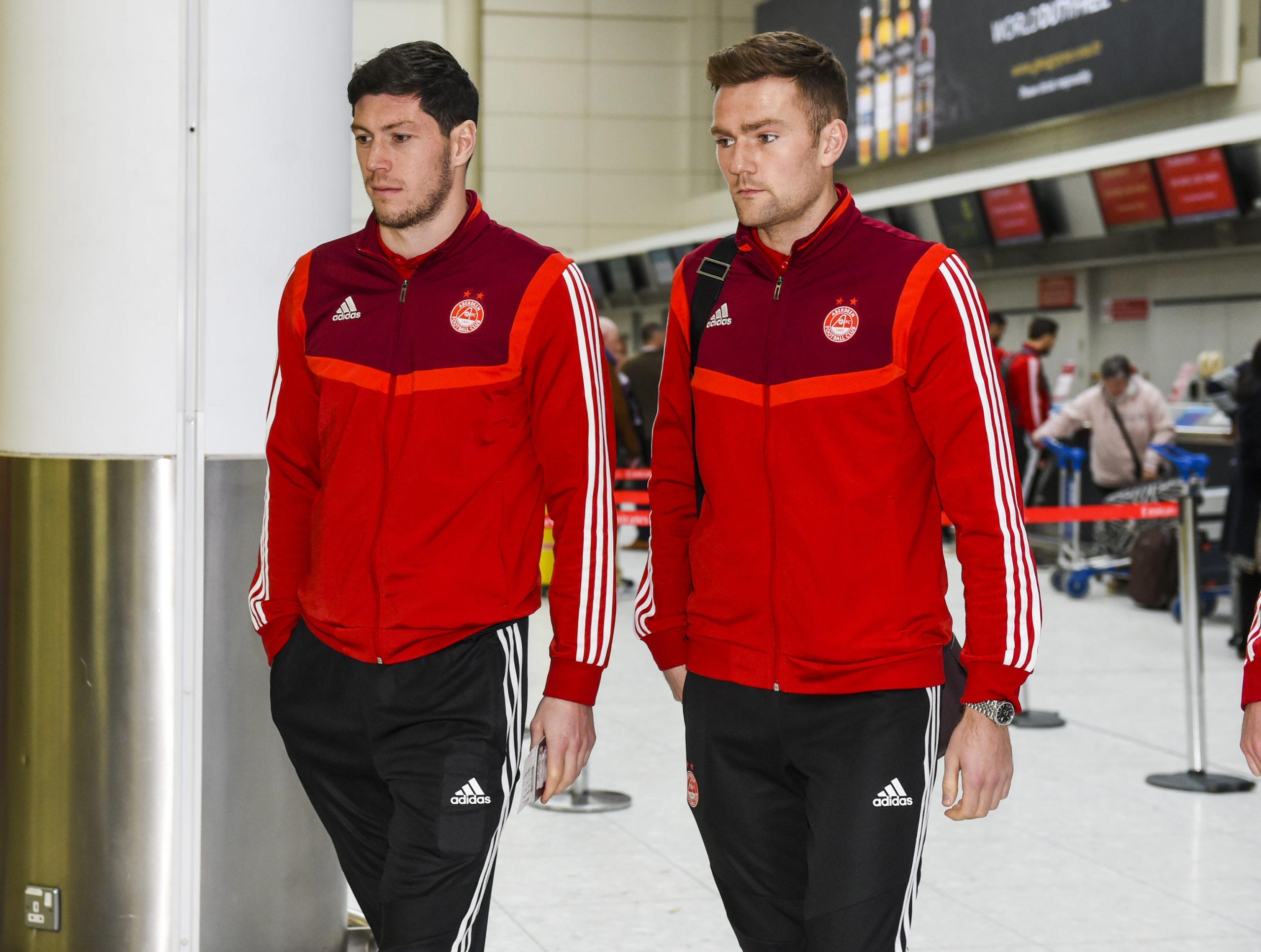 Devlin with Aberdeen team-mate Scott McKenna.