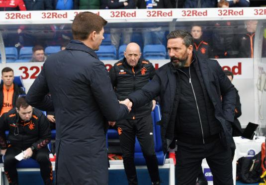 Aberdeen manager Derek McInnes (right) shakes hands with Rangers manager Steven Gerrard.