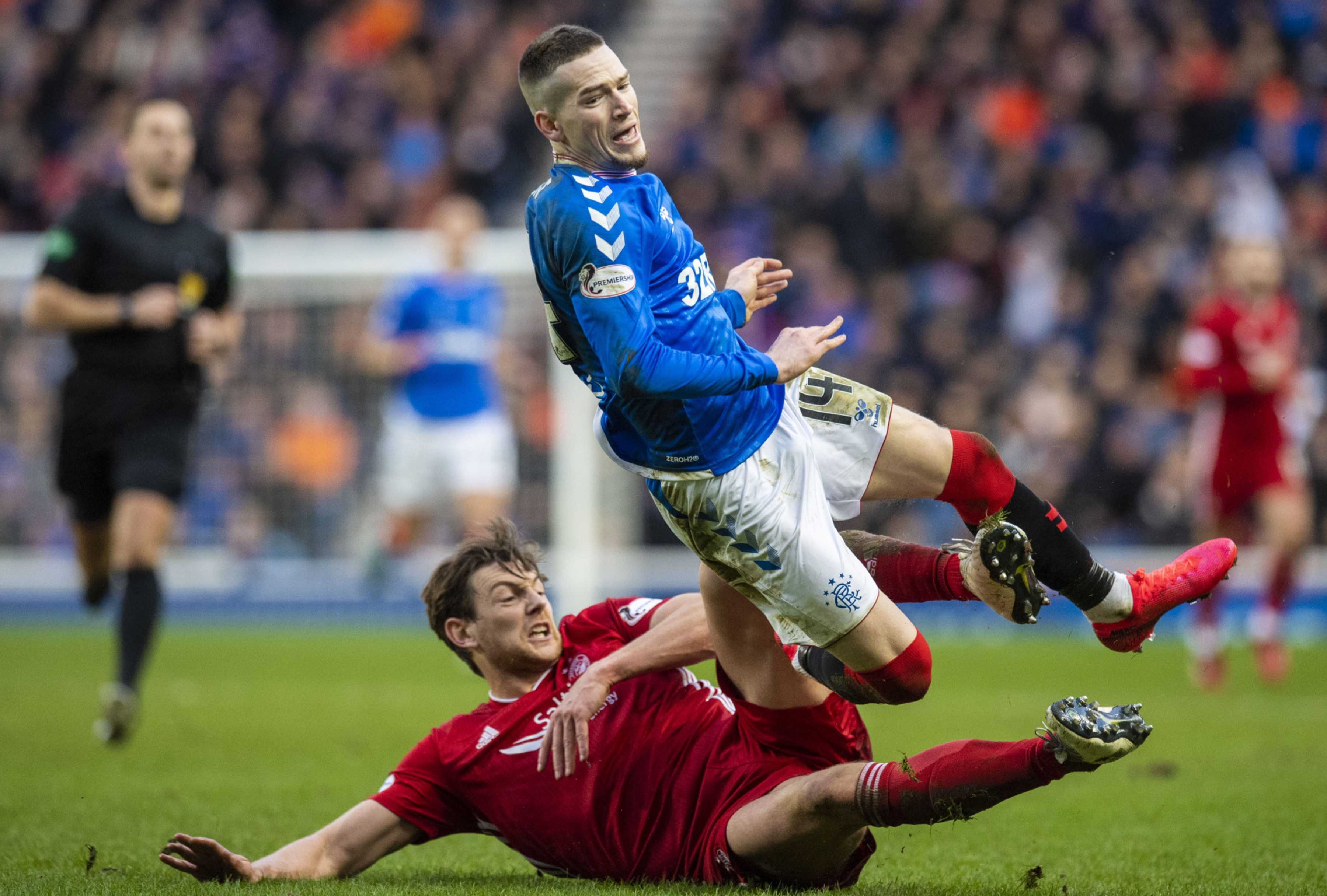 Ash Taylor tackles Ryan Kent during Aberdeen's 0-0 draw with Rangers at Ibrox