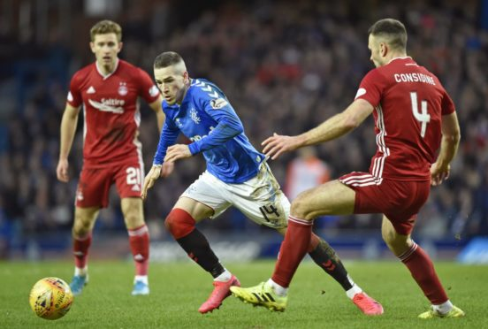 Aberdeen's Andrew Considine tackles Ryan Kent at Ibrox