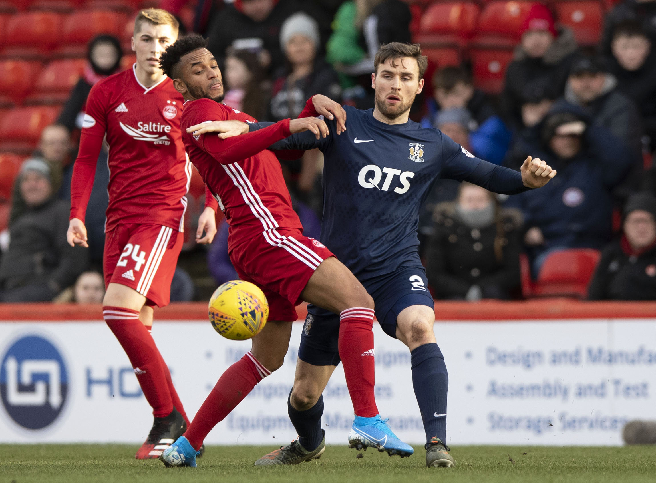 Dean Campbell looks on as Funso Ojo battles with Kilmarnock's Stephen O'Donnell.