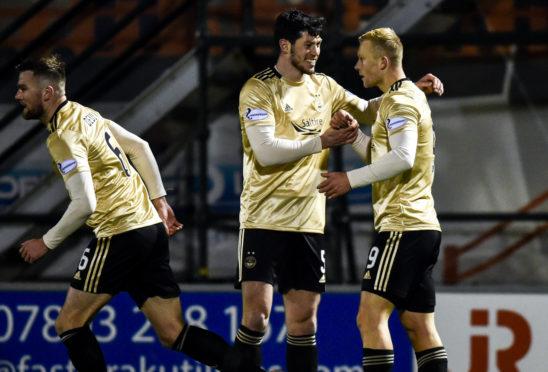 Curtis Main celebrates with Scott McKenna after scoring to make it 1-0 Aberdeen during the Ladbrokes Premiership match between Hamilton and Aberdeen.