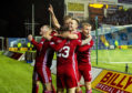 Andrew Considine leads the celebrations after Aberdeen made it 4-3 against Kilmarnock.