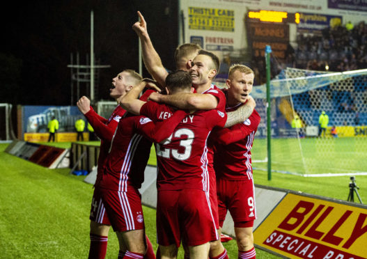 Andrew Considine leads the celebrations after Aberdeen made it 4-3 against Kilmarnock to reach the Scottish Cup quarter-finals.