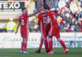Dean Campbell is consoled by team-mates after being sent off during the Ladbrokes Premiership match between Aberdeen and Ross County.