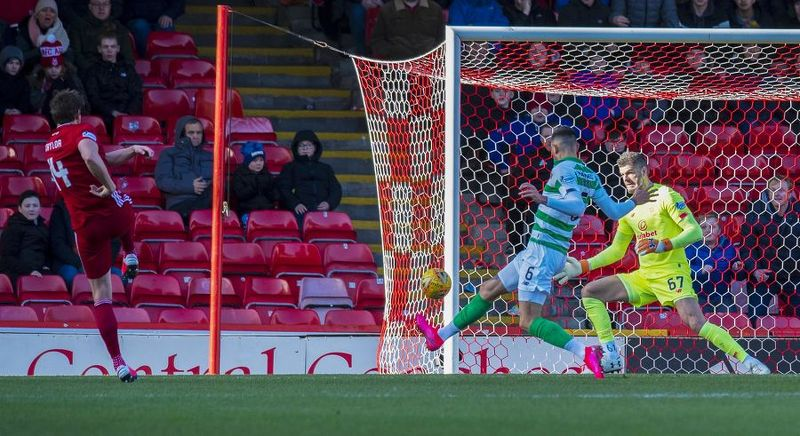 Ash Taylor volleys home for Aberdeen to level against Celtic.