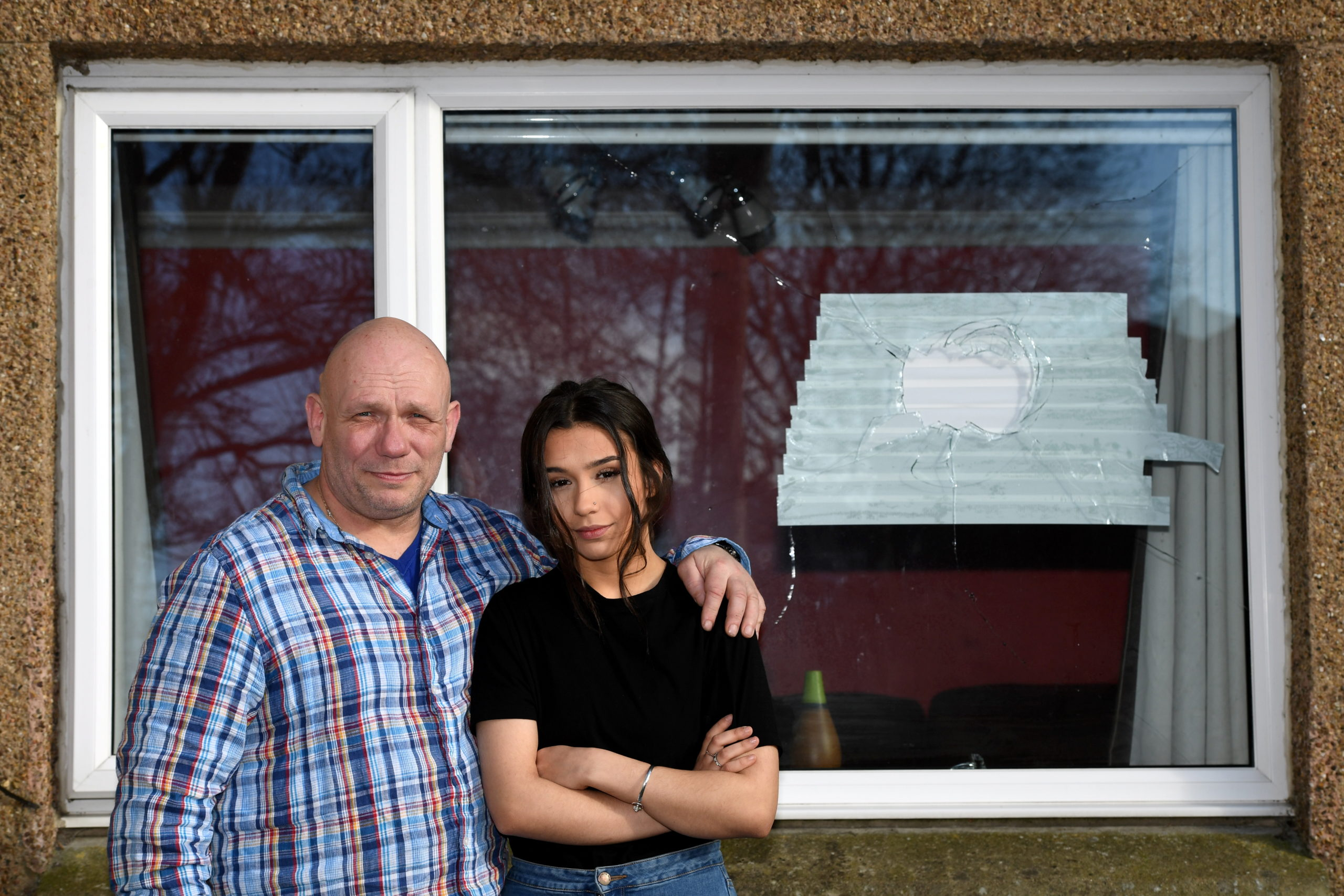 Andy Keay with his daughter Alicia. A brick was thrown through their window this week