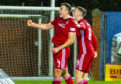 Andrew Considine celebrates with Lewis Ferguson after equalising at Rugby Park
