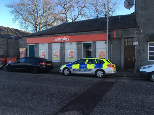 Officers remained at Ladbrokes on South Esplanade East for much of today.