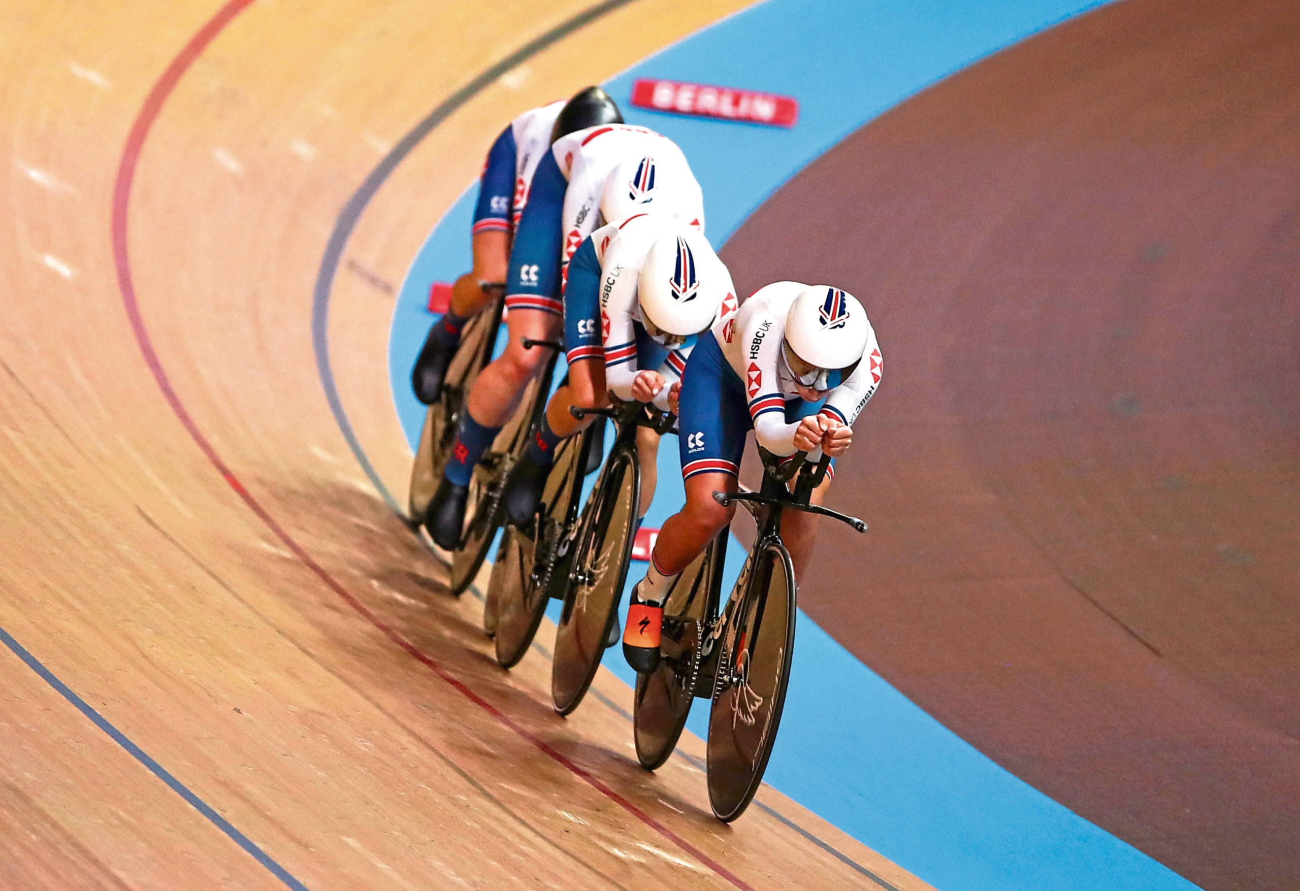 Great Britain's Neah Evans leads her team in women's team pursuit qualifying.