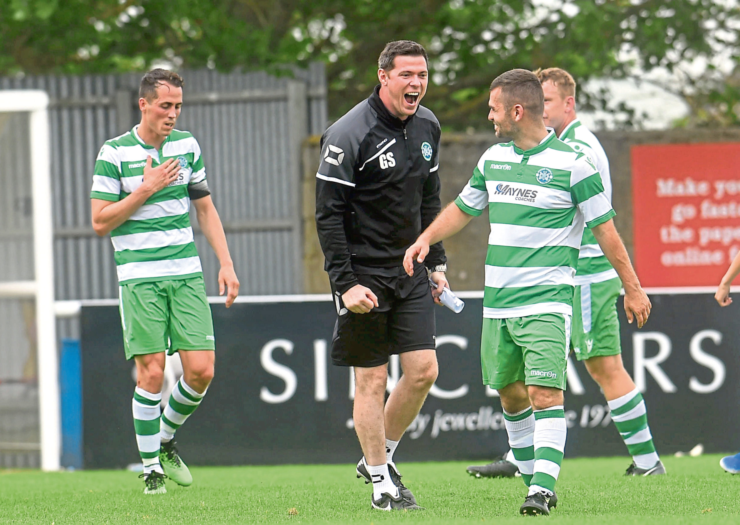 Graeme Stewart with his players.