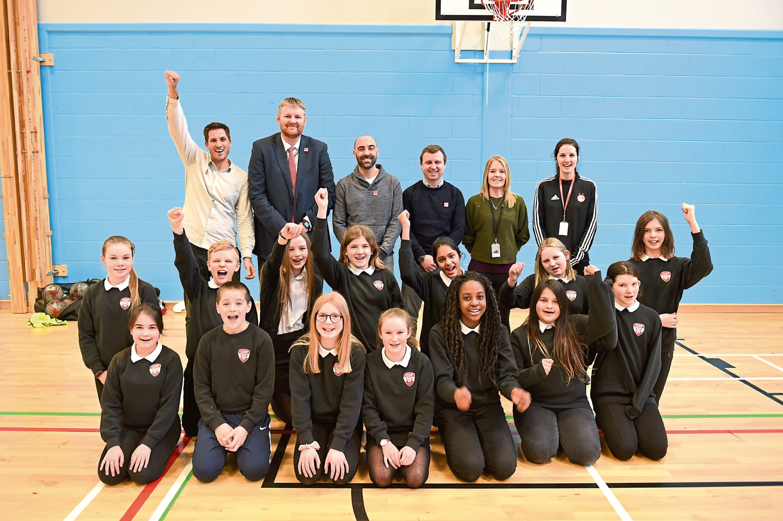 Lochside Academy pupils with Chris Barkley from Grassroot Soccer, head teacher Neil Hendry, Jeff DeCelles of Grassroot Soccer, Steven Sweeney of AFCCT, Holly Hillson-Dawson of Grassroot Soccer and instructor Laura Whitfield