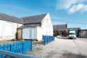Market Place Primary in Inverurie has lain empty since October 2017 and is now being stripped out inside ahead of its demolition. Picture by Jim Irvine