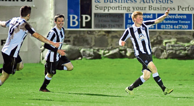Owen Cairns, right, is celebrating.