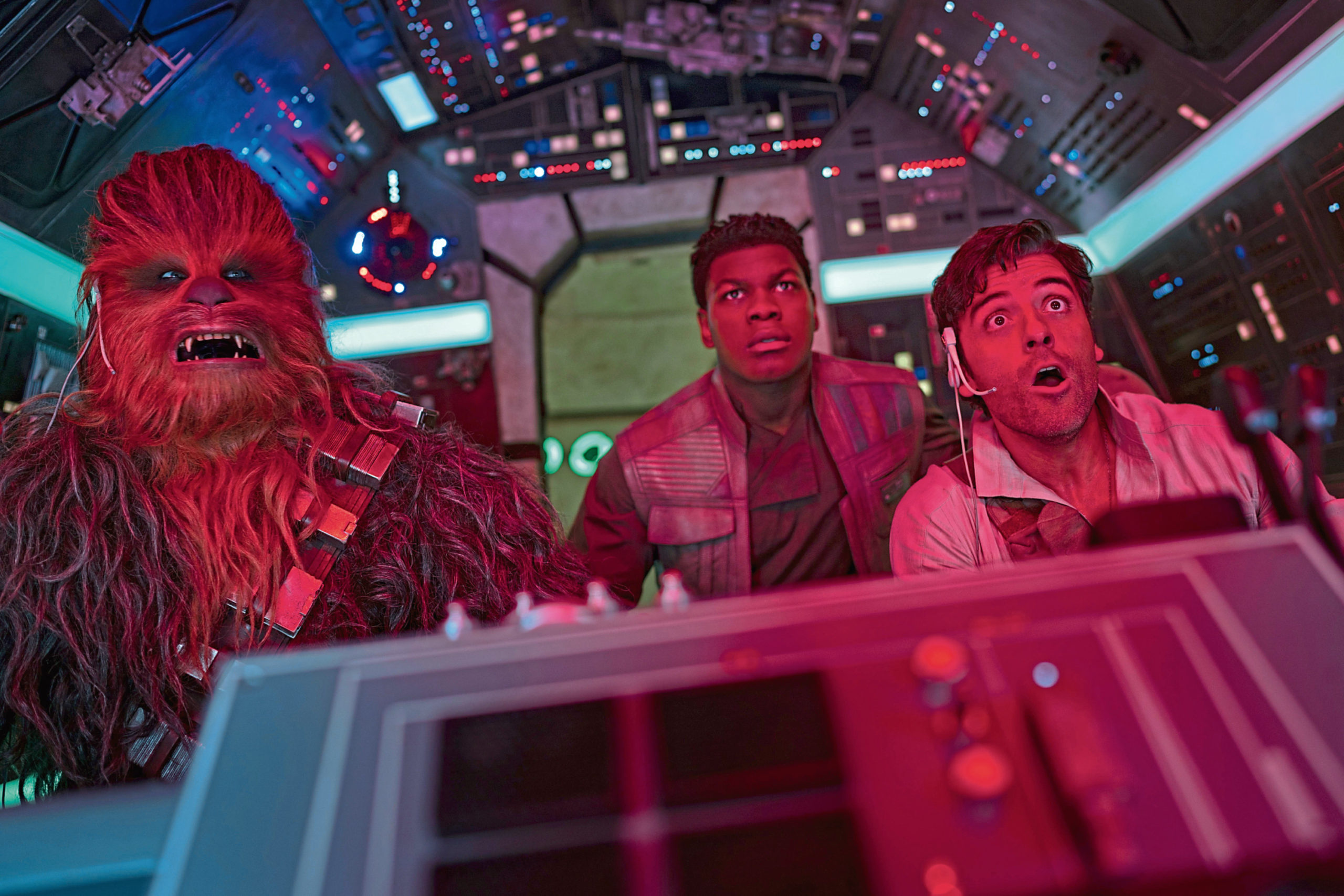 Joonas Suotamo, Chewbacca; John Boyega, Finn; and Oscar Isaac, Poe, in Star Wars: The Rise of Skywalker