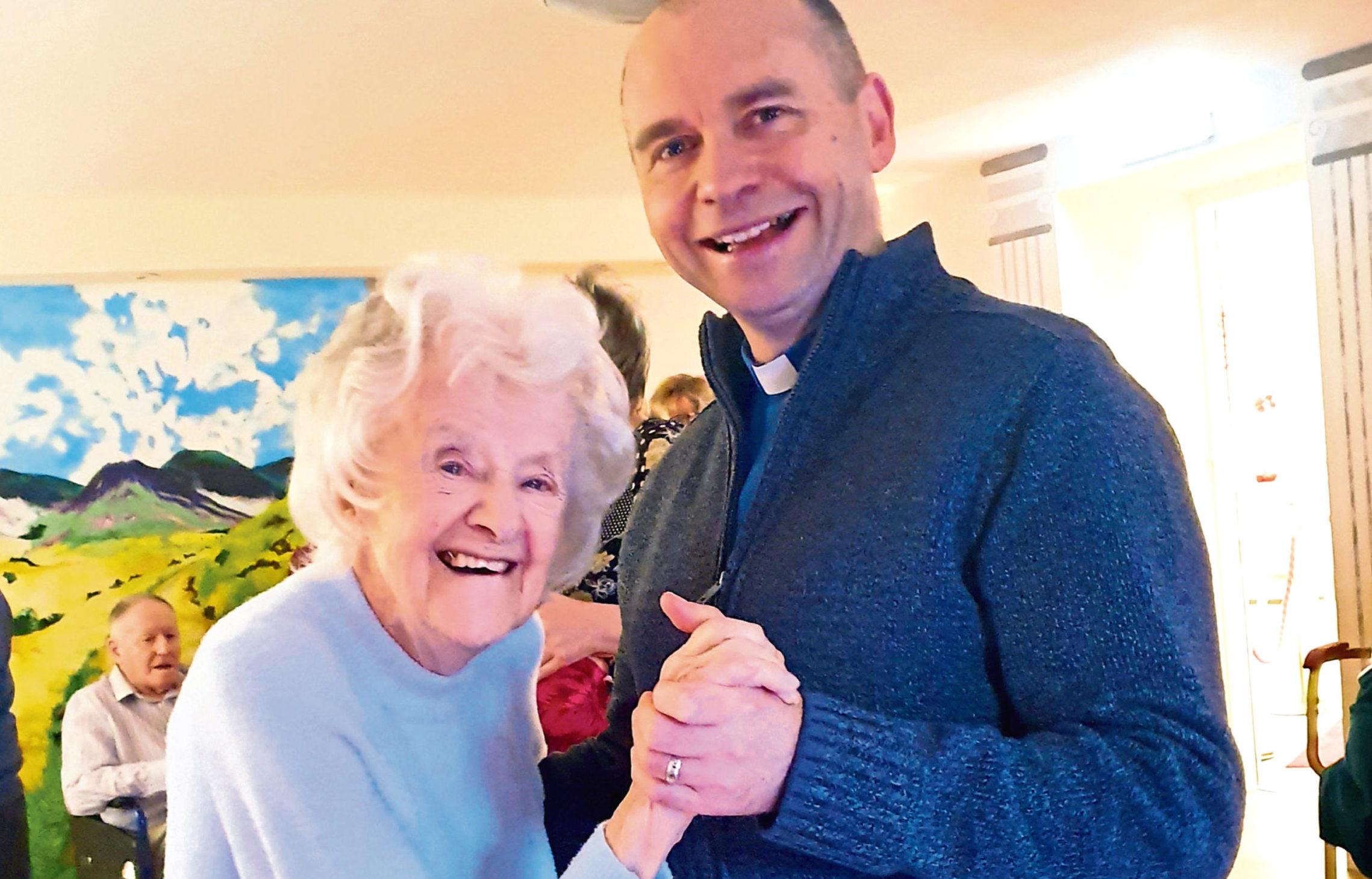 Resident Brenda Dickinson has a dance with Rev Dr Paul McKeown