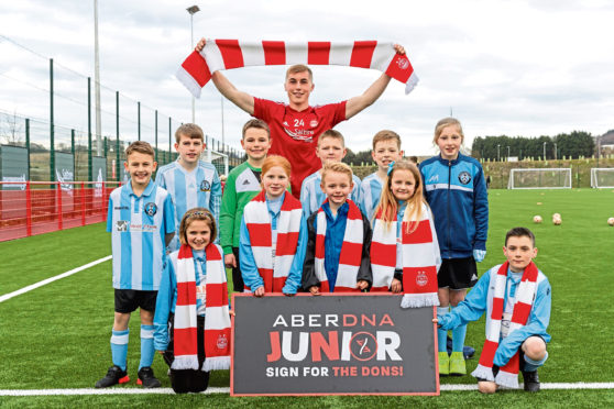 Dean Campbell launches the AberDNA Junior campaign with a little help from some young Dons in the city
