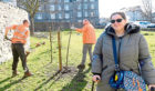 Julie-Anne Butchart with council workers Paul Williams and Scott Menhinick planting on Roslin Terrace