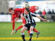 Brora's John Pickles and Fraserburgh's Ryan Sargent during one of their meetings this season. Picture by Kath Flannery