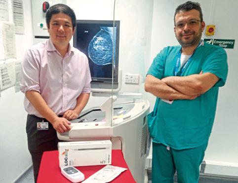Dr Gerald Lip, left, and Mr Yazan Masannat with the new screening technology at ARI