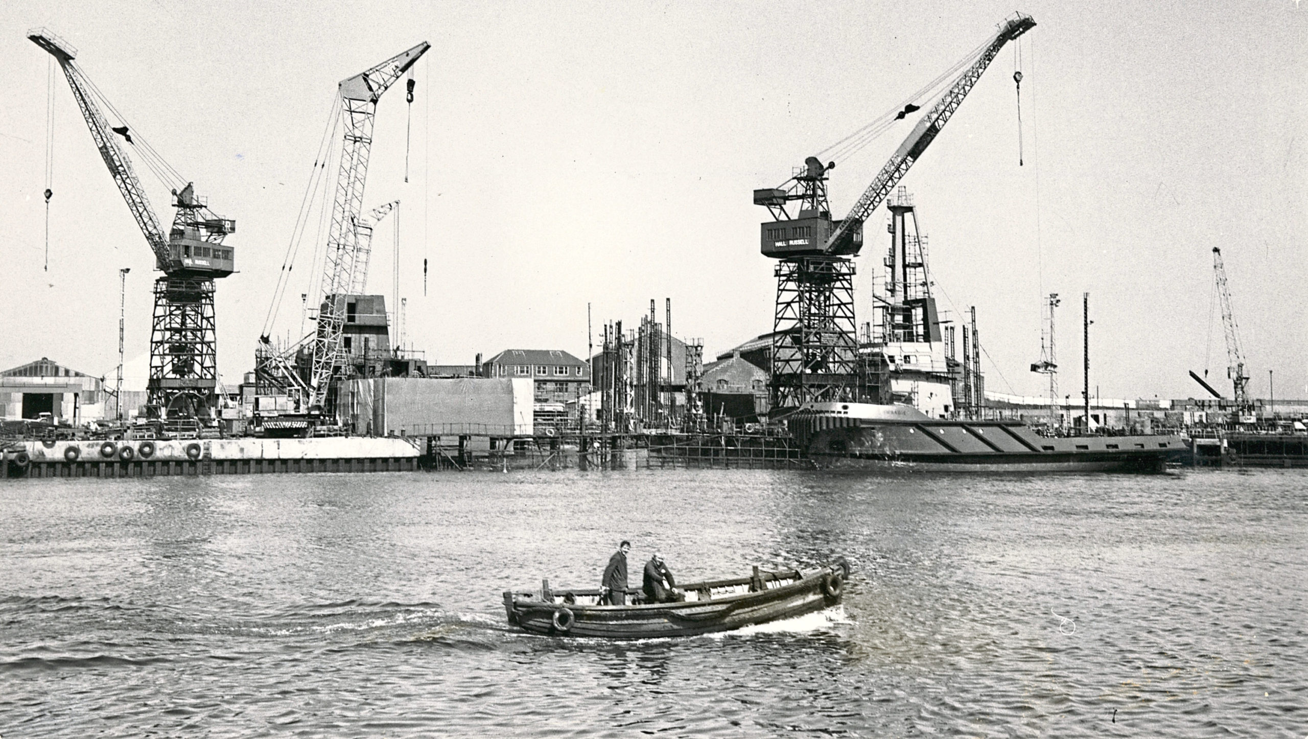 Busy scenes at the Hall Russell and Co Ltd shipbuilding yard, Aberdeen. On right is the Sullom Voe oil terminal tug Swaabie at the fitting out berth