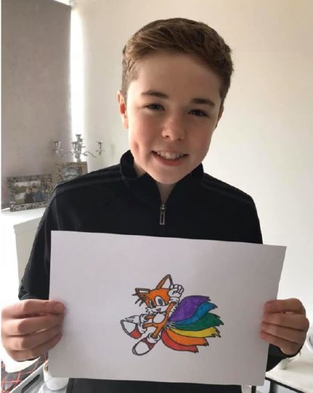Alex, 12, and his rainbow drawing