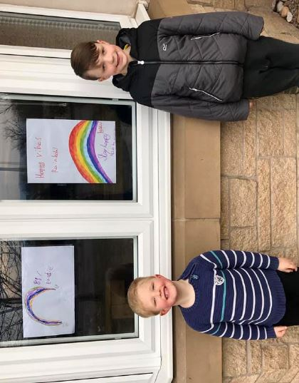 Brodie, 5 and Lewis, 8 with their rainbows