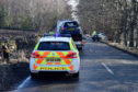 Police at the scene of the crash on the A93 near Crathes