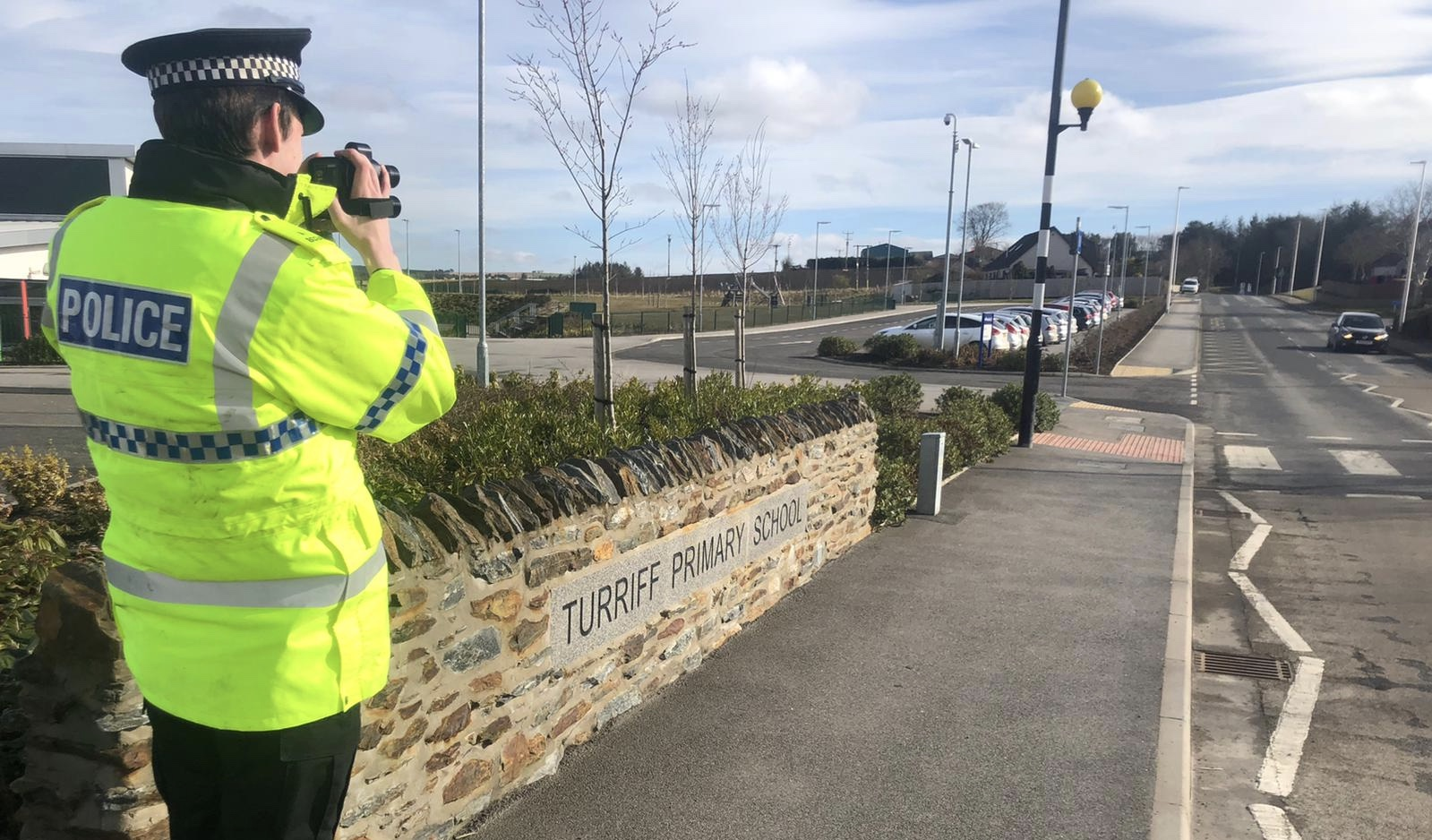 An officer outside Turriff Primary School