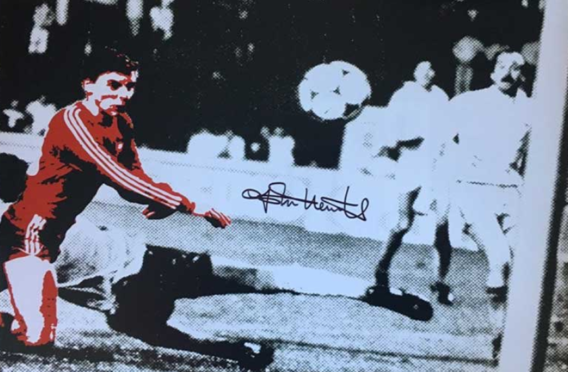 The signed John Hewitt image being auctioned off.