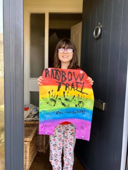 Kirsty aged ten and her rainbow sign